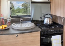 Phoenix-642-kitchen-featuring-Thetford-'K-Series'-combined-oven-grill-and-hob-with-electronic-ignition-and-flame-failure-device