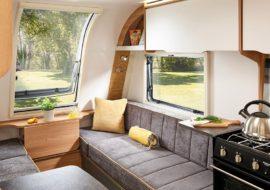 Discovery-D4-2-Lounge-with-Lana-Grey-matt-overhead-locker-doors-and-Java-soft-furnishings