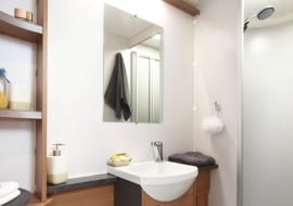 Discovery-D4-4-bathroom-with-Granite-Stone-fully-lined-shower-cubicle-and-bi-fold-partition-door